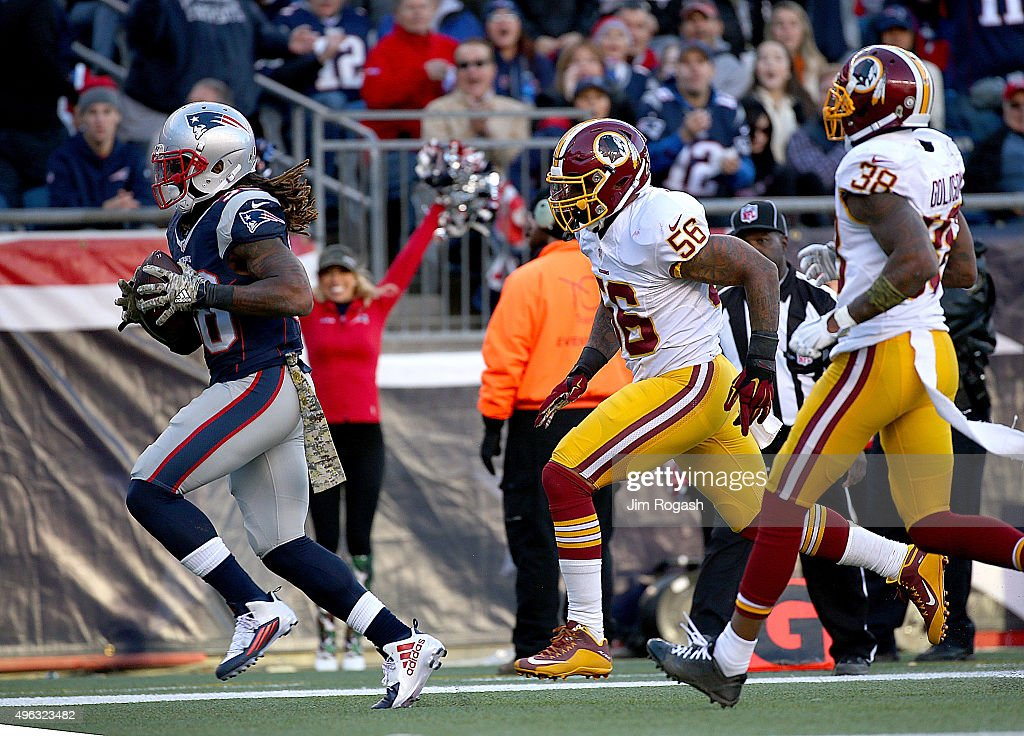 Brandon Bolden of the New England Patriots catches a touchdown pass as Dashon Goldson and Perry Riley of the Washington Redskins defends in the...