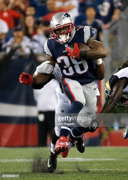 Brandon Bolden of the New England Patriots runs in the first half of a preseason game against the Jacksonville Jaguars at Gillette Stadium on August...