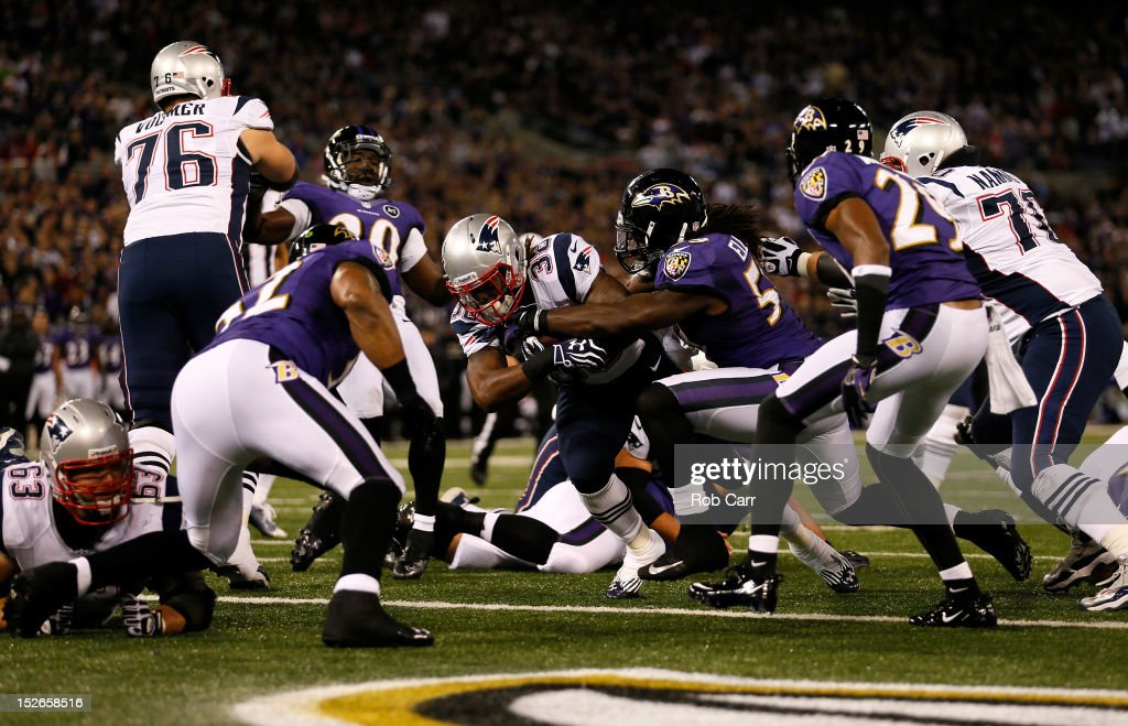 Brandon Bolden #38 of the New England Patriots scores a 2-yard rushing touchdown in the first quarter against Dannell Ellerbe #59 of the Baltimore Ravens at M&T Bank Stadium on September 23, 2012 in Baltimore, Maryland.