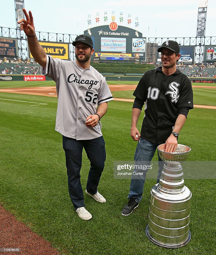 Brandon Bollig #52 and Patrick Sharp #10 of the Chicago Blackhawks make an appearance with the Stanley Cup before the Chicago White Sox take on the Baltimore Orioles at U.S. Cellular Field on July 3, 2013 in Chicago, Illinois.