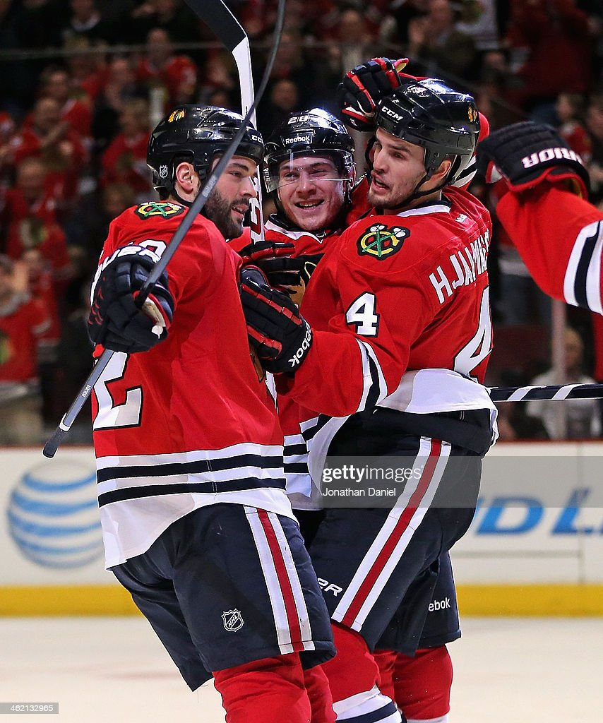 <a gi-track='captionPersonalityLinkClicked' href=/galleries/search?phrase=Brandon+Bollig&family=editorial&specificpeople=7186858 ng-click='$event.stopPropagation()'>Brandon Bollig</a> #52, Ben Smith #28 and Hiklas Hjalmarsson #4 of the Chicago Blackhawks celebrate Smiths first period goal against the Edmonton Oilers at the United Center on January 12, 2014 in Chicago, Illinois.