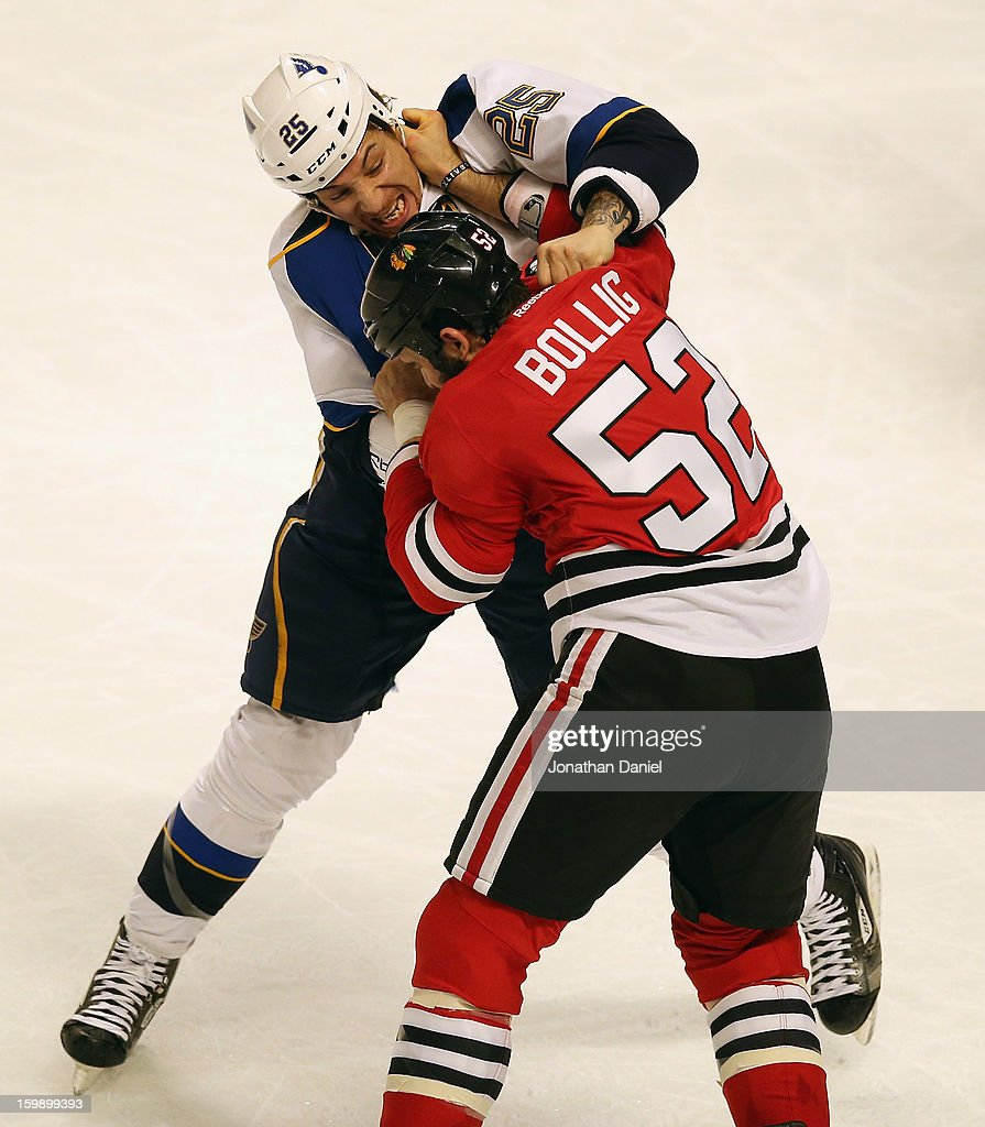Brandon Bollig #52 of the Chicago Blackhawks and Chris Stewart #25 of the St. Louis Blues fight in the first period at the United Center on January 22, 2013 in Chicago, Illinois.