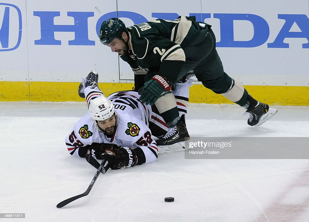 <a gi-track='captionPersonalityLinkClicked' href=/galleries/search?phrase=Brandon+Bollig&family=editorial&specificpeople=7186858 ng-click='$event.stopPropagation()'>Brandon Bollig</a> #52 of the Chicago Blackhawks and <a gi-track='captionPersonalityLinkClicked' href=/galleries/search?phrase=Keith+Ballard+-+Ice+Hockey+Player&family=editorial&specificpeople=630546 ng-click='$event.stopPropagation()'>Keith Ballard</a> #2 of the Minnesota Wild watch the puck during the third period in Game Three of the Second Round of the 2014 NHL Stanley Cup Playoffs on May 6, 2014 at Xcel Energy Center in St Paul, Minnesota. The Wild defeated the Blackhawks 4-0.