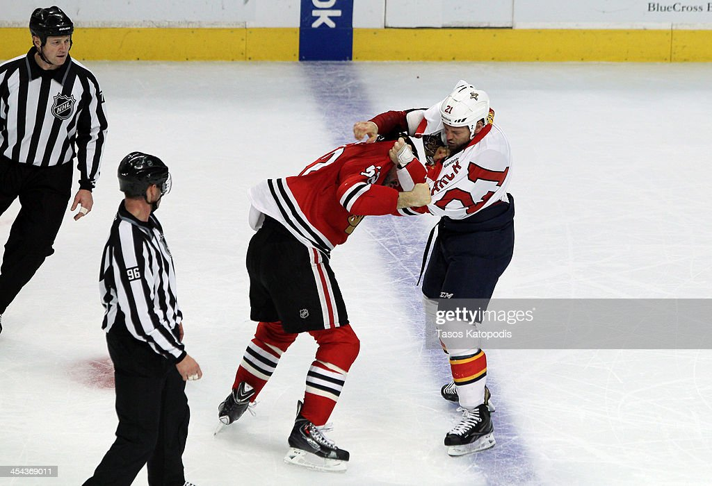 CHICAGO, IL - DECEMBER <a gi-track='captionPersonalityLinkClicked' href=/galleries/search?phrase=Brandon+Bollig&family=editorial&specificpeople=7186858 ng-click='$event.stopPropagation()'>Brandon Bollig</a> #52 of the Chicago Blackhawks and <a gi-track='captionPersonalityLinkClicked' href=/galleries/search?phrase=Krys+Barch&family=editorial&specificpeople=2538220 ng-click='$event.stopPropagation()'>Krys Barch</a> #21 of the Florida Panthers fight on the ice in the third period of play at the United Center on December 8, 2013 in Chicago, Illinois.