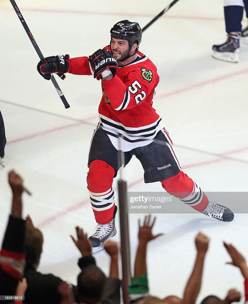 Brandon Bollig #52 of the Chicago Blackhawks celebrates a first period goal against the Washington Capitals at the United Center on October 1, 2013 in Chicago, Illinois.