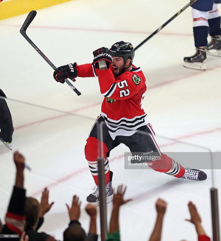 <a gi-track='captionPersonalityLinkClicked' href=/galleries/search?phrase=Brandon+Bollig&family=editorial&specificpeople=7186858 ng-click='$event.stopPropagation()'>Brandon Bollig</a> #52 of the Chicago Blackhawks celebrates his first NHL goal against the Washington Capitals at the United Center on October 1, 2013 in Chicago, Illinois. The Blackhawks defeated the Capitals 6-4.
