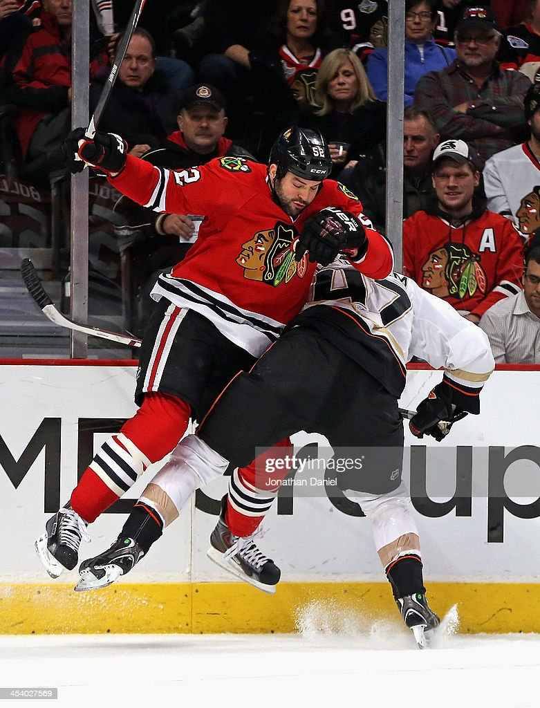 <a gi-track='captionPersonalityLinkClicked' href=/galleries/search?phrase=Brandon+Bollig&family=editorial&specificpeople=7186858 ng-click='$event.stopPropagation()'>Brandon Bollig</a> #52 of the Chicago Blackhawks collides with <a gi-track='captionPersonalityLinkClicked' href=/galleries/search?phrase=Hampus+Lindholm&family=editorial&specificpeople=8630299 ng-click='$event.stopPropagation()'>Hampus Lindholm</a> #47 of the Anaheim Ducks at the United Center on December 6, 2013 in Chicago, Illinois.