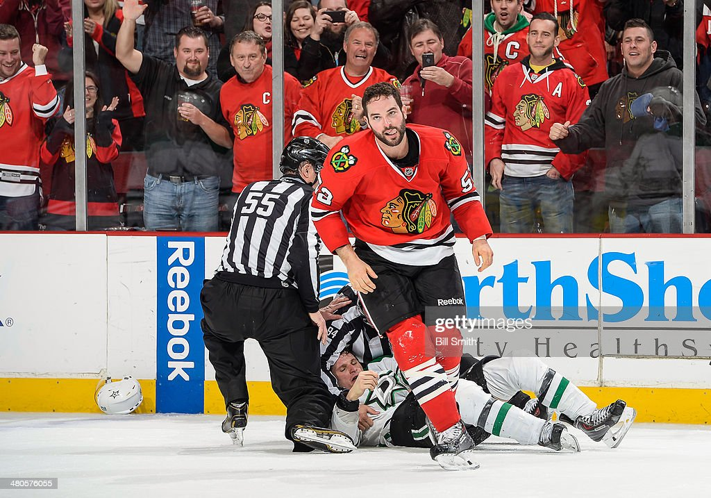 <a gi-track='captionPersonalityLinkClicked' href=/galleries/search?phrase=Brandon+Bollig&family=editorial&specificpeople=7186858 ng-click='$event.stopPropagation()'>Brandon Bollig</a> #52 of the Chicago Blackhawks skates away after an altercation with <a gi-track='captionPersonalityLinkClicked' href=/galleries/search?phrase=Antoine+Roussel&family=editorial&specificpeople=4202700 ng-click='$event.stopPropagation()'>Antoine Roussel</a> #21 of the Dallas Stars during the NHL game on March 25, 2014 at the United Center in Chicago, Illinois.