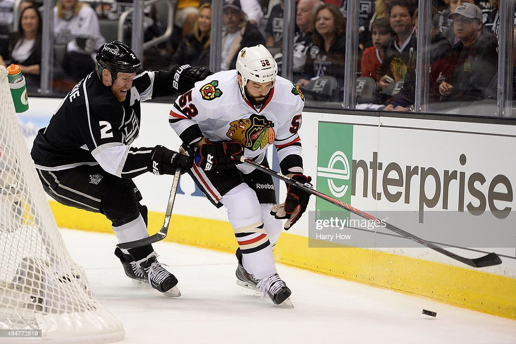 Brandon Bollig #52 of the Chicago Blackhawks with the puck against Matt Greene #2 of the Los Angeles Kings in Game Six of the Western Conference Final during the 2014 Stanley Cup Playoffs at Staples Center on May 30, 2014 in Los Angeles, California.