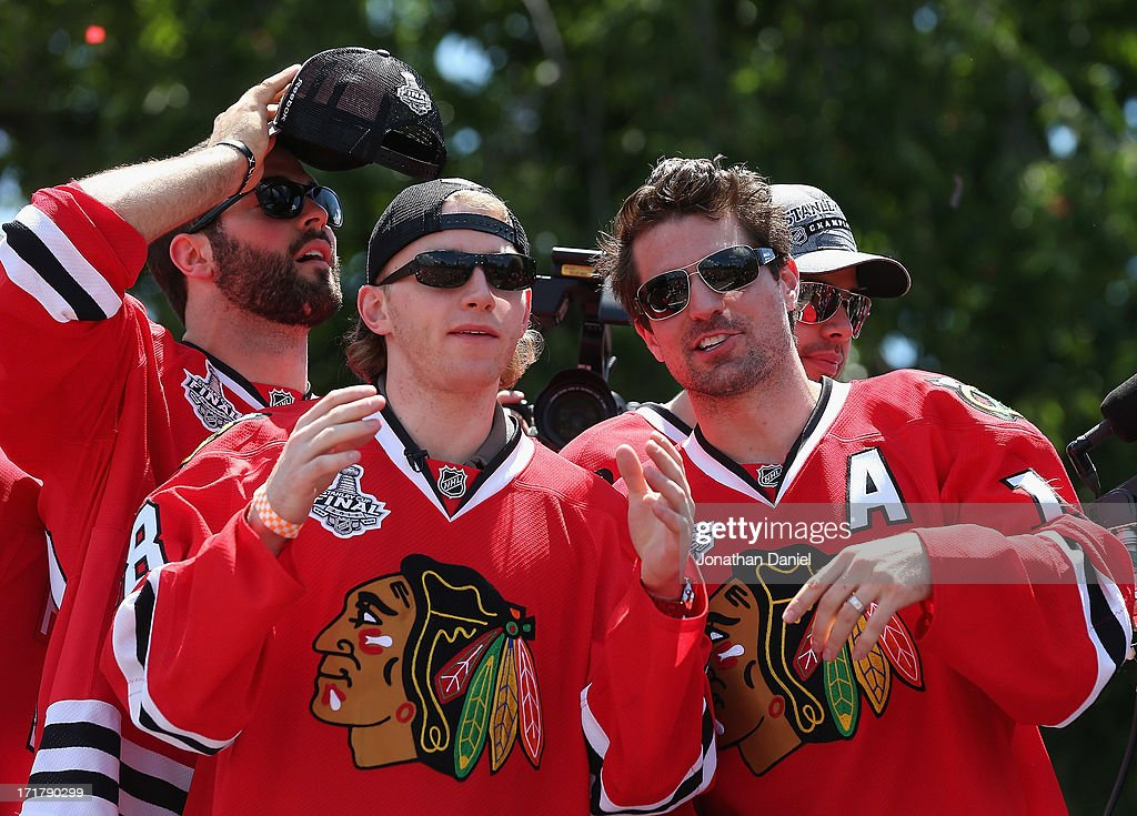 Brandon Bollig #52, Patrick Kane #88, Patrick Sharp #10 and Corey Crawford #50 of the Chicago Blackhawks enjoy the ceremony during the Blackhawks Victory Parade and Rally on June 28, 2013 in Chicago, Illinois.