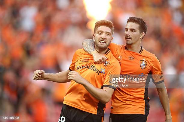 Brandon Borello of the Roar celebrates with team mate Jamie Maclaren after scoring a goal during the round four ALeague match between the Brisbane...