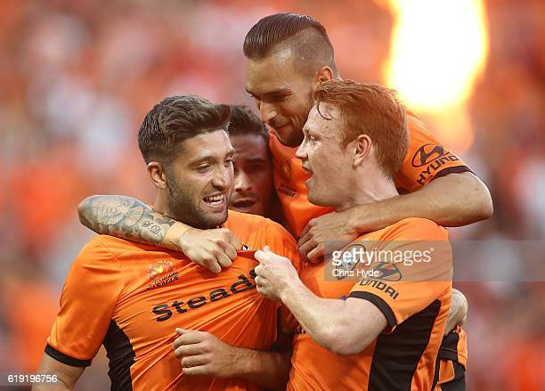 Brandon Borello of the Roar celebrates with team mates after scoring a goal during the round four ALeague match between the Brisbane Roar and Perth...
