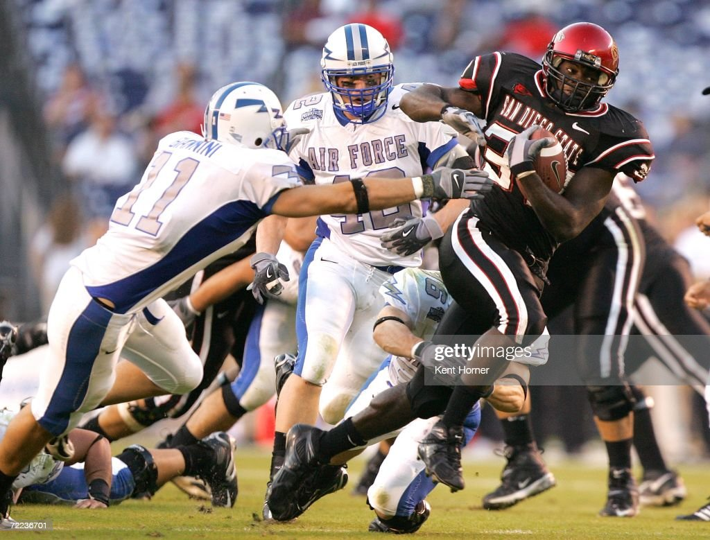 Brandon Bornes #37 of the San Diego State Aztecs runs with the ball against Bobby Giannini #11 of the Air Force Falcons on Saturday October 21, 2006 during their game at Qualcomm Stadium in San Diego, California. The Aztecs upset the Falcons 19-12.