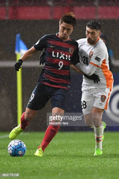 Brandon Borrello of Brisbane and Yuma Suzuki of Kashima Antlers compete for the ball during the AFC Champions League Group E match between Kashima...