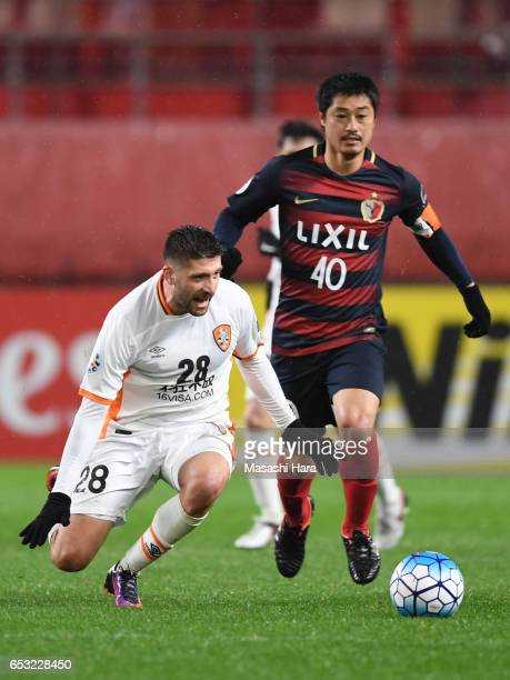 Brandon Borrello of Brisbane Roar and Mitsuo Ogasawara of Kashima Antlers compete for the ball during the AFC Champions League Group E match between...