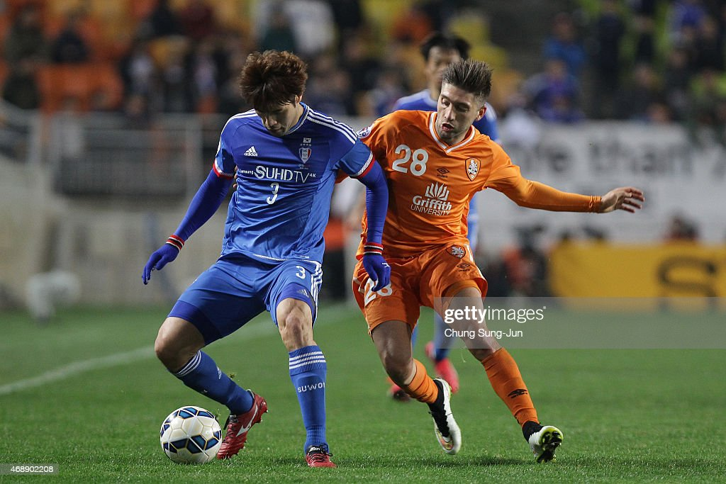 Brandon Borrello of Brisbane Roar compete for the ball with Yang SangMin of Suwon Samsung FC during the AFC Champions League Group G match between...