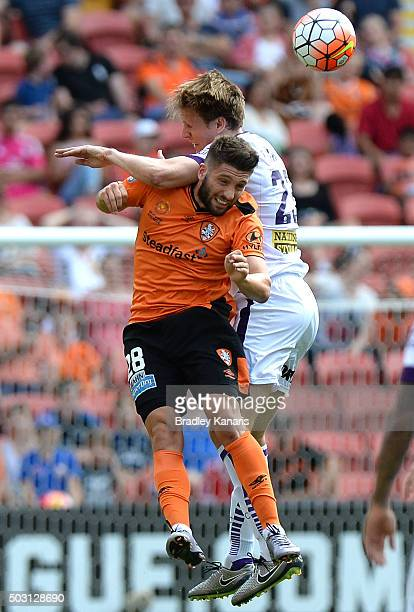 Brandon Borrello of the Roar and Michael Thwaite of the Glory challenge for the ball during the round 13 ALeague match between the Brisbane Roar and...
