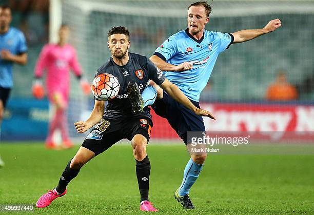 Brandon Borrello of the Roar and Rhyan Grant of Sydney contest possession during the round five ALeague match between Sydney FC and Brisbane Roar at...