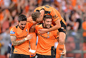 Brandon Borrello of the Roar celebrates scoring a goal with team mates during the round four ALeague match between Brisbane Roar and Adelaide United...