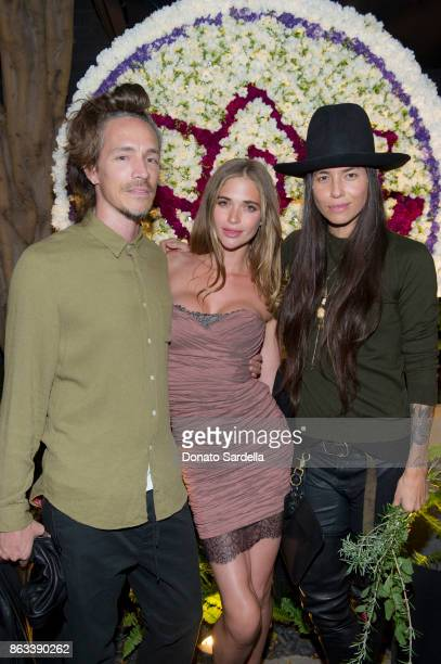 Brandon Boyd Tasya van Ree and guest at Living Beauty 'The Gift' Photo Exhibit at The Buterbaugh Gallery on October 19 2017 in Los Angeles California