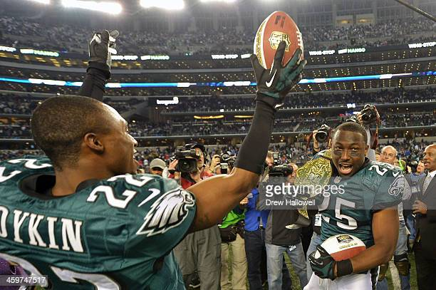 Brandon Boykin and LeSean McCoy of the Philadelphia Eagles celebrate after the game against the Dallas Cowboys at ATT Stadium on December 29 2013 in...