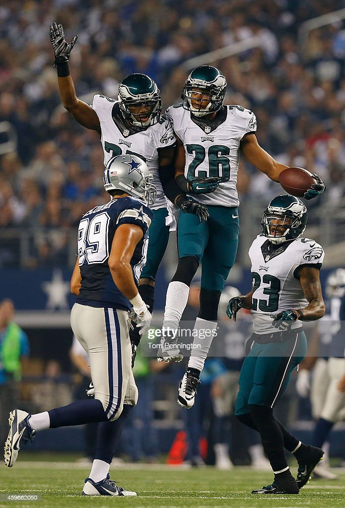 Brandon Boykin #22 of the Philadelphia Eagles and Cary Williams #26 of the Philadelphia Eagles celebrate Williams' interception as Gavin Escobar #89 of the Dallas Cowboys and Jakar Hamilton #23 of the Dallas Cowboys are near in the second half at AT&T Stadium on November 27, 2014 in Arlington, Texas.