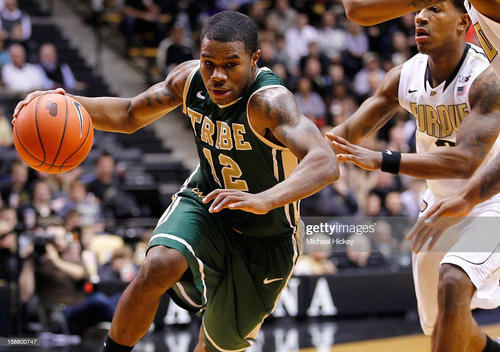 Brandon Britt #12 of the William & Mary Tribe dribbles the ball to the basket against the Purdue Boilermakers at Mackey Arena on December 29, 2012 in West Lafayette, Indiana. Purdue defeated William & Mary 73-66.