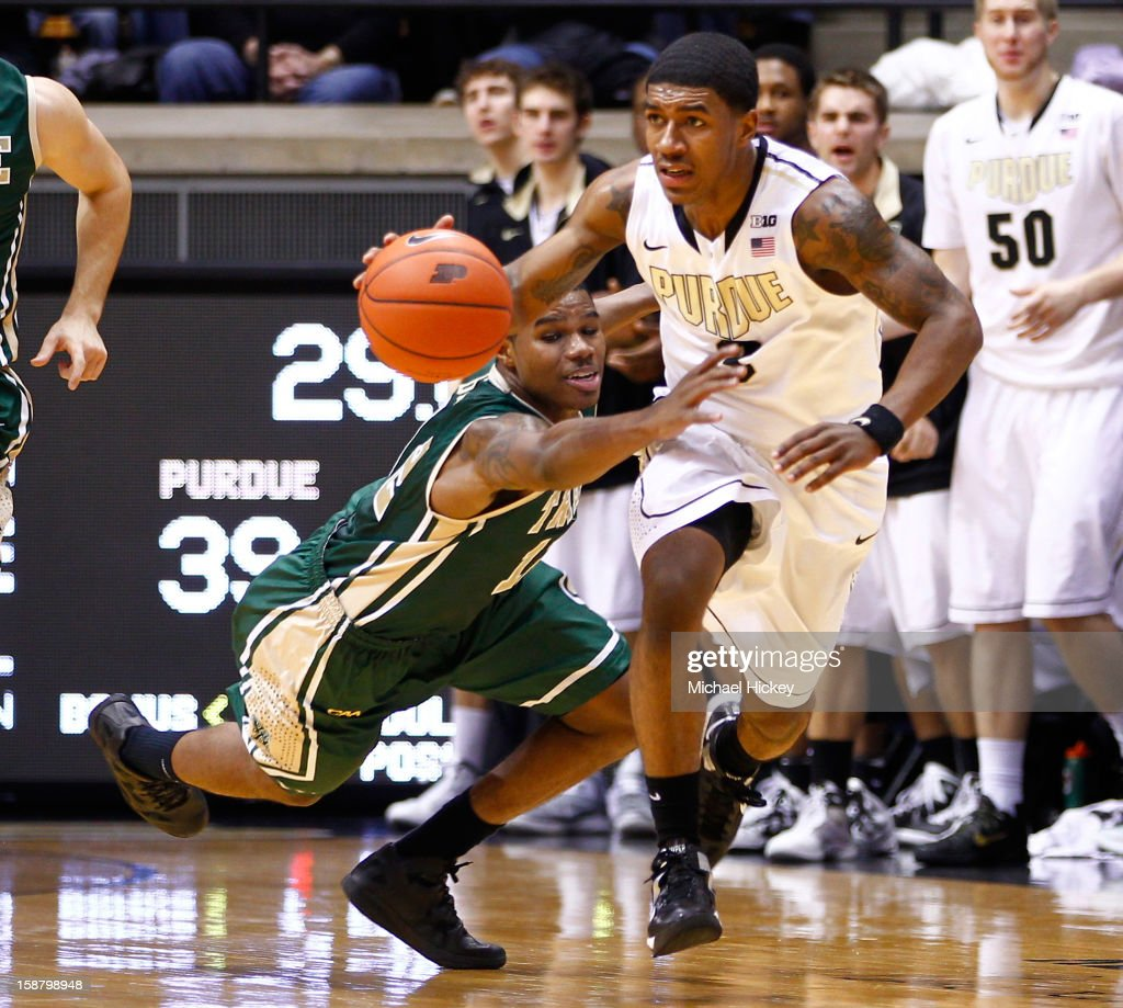 Brandon Britt #12 of the William & Mary Tribe reaches in for the ball as Ronnie Johnson #3 of the Purdue Boilermakers dribbles the up court at Mackey Arena on December 29, 2012 in West Lafayette, Indiana.