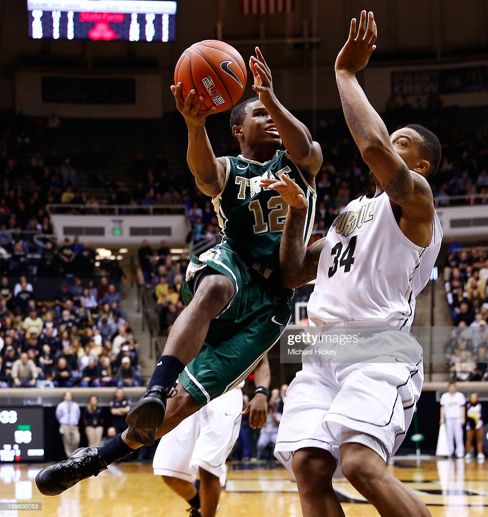 Brandon Britt #12 of the William & Mary Tribe shoots the ball against Jacob Lawson #34 of the Purdue Boilermakers at Mackey Arena on December 29, 2012 in West Lafayette, Indiana. Purdue defeated William & Mary 73-66.
