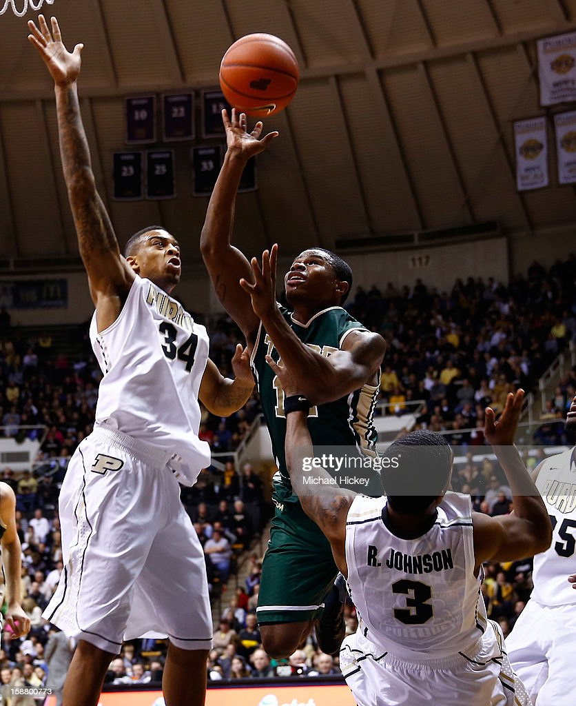 Brandon Britt #12 of the William & Mary Tribe shoots the ball as Jacob Lawson #34 and Ronnie Johnson #3 of the Purdue Boilermakers defend at Mackey Arena on December 29, 2012 in West Lafayette, Indiana. Purdue defeated William & Mary 73-66.