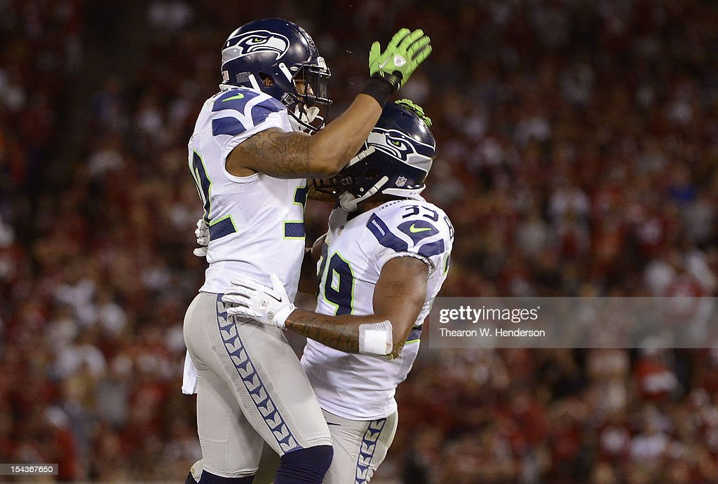 <a gi-track='captionPersonalityLinkClicked' href=/galleries/search?phrase=Brandon+Browner&family=editorial&specificpeople=749482 ng-click='$event.stopPropagation()'>Brandon Browner</a> #39 and Jeron Johnson #32 celebrates after Browner intercepted a pass in the endzone against the San Francisco 49ers during the fourth quarter of an NFL football game at Candlestick Park on October 18, 2012 in San Francisco, California. The 49ers won the game 13-6.