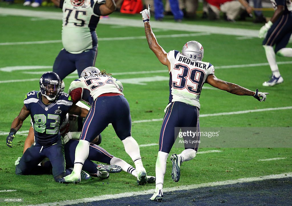 Brandon Browner of the New England Patriots celebrates an interception by Malcolm Butler in the fourth quarter on the two yard line against the...