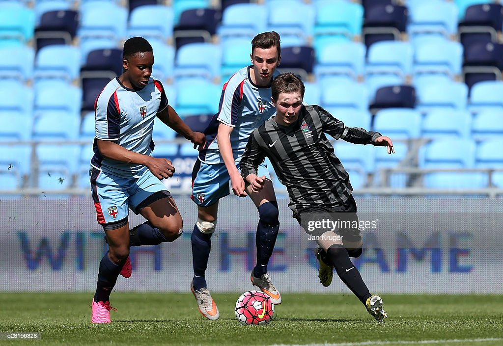 Brandon Burrows of Blacon High School battles with Donnell Bowes of King Edwards's School Witley during the Premier League under 16 Small Schools' Cup final match between King Edwards's School Witley and Blacon High School at the Academy Training Ground on May 04, 2016 in Manchester, England.