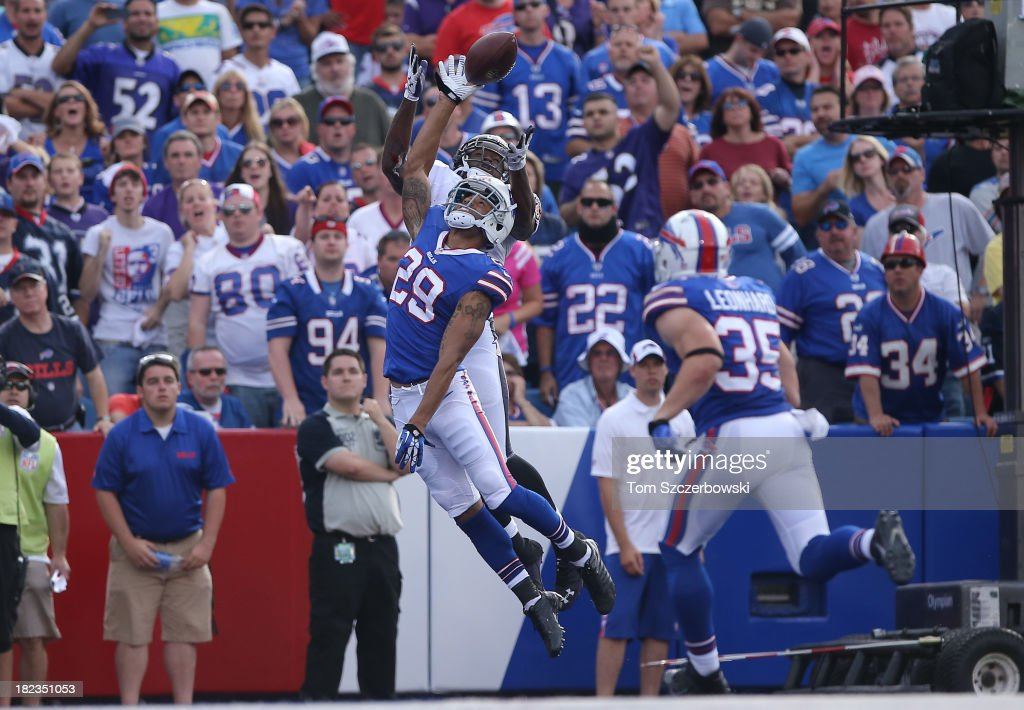 Brandon Burton of the Buffalo Bills breaks up a pass in the end zone during NFL game action intended for Torrey Smith of the Baltimore Orioles at...