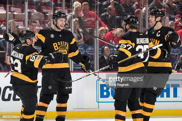 Brandon Carlo of the Boston Bruins celebrates his first period goal with teammates Brad Marchand Patrice Bergeron and Zdeno Chara during an NHL game...