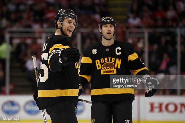 Brandon Carlo of the Boston Bruins celebrates his first period goal with Zdeno Chara while playing the Detroit Red Wings at Joe Louis Arena on...