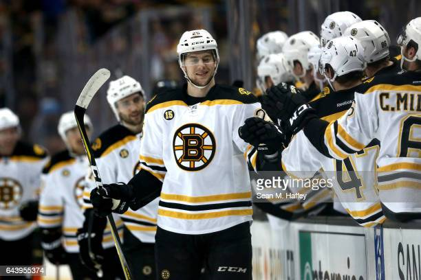 Brandon Carlo of the Boston Bruins is congratulated by teammates after scoring a goal during the first period of a game against the Anaheim Ducks at...