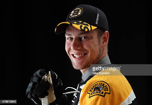 Brandon Carlo poses after being selected 37th overall by the Boston Bruins during the 2015 NHL Draft at BBT Center on June 27 2015 in Sunrise Florida