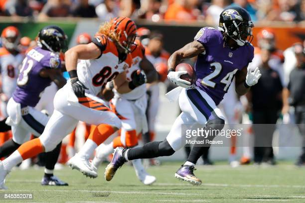 Brandon Carr of the Baltimore Ravens runs with the ball after intercepting a pass during the second quarter of the game against the Cincinnati...