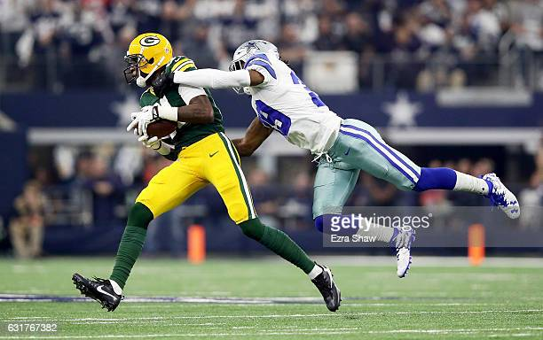 Brandon Carr of the Dallas Cowboys attempts to tackle Geronimo Allison of the Green Bay Packers in the first half during the NFC Divisional Playoff...