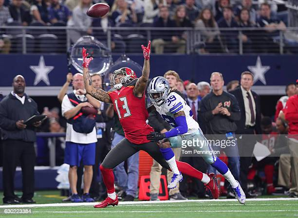 Brandon Carr of the Dallas Cowboys defends a pass to Mike Evans of the Tampa Bay Buccaneers during the first quarter of their game at ATT Stadium on...