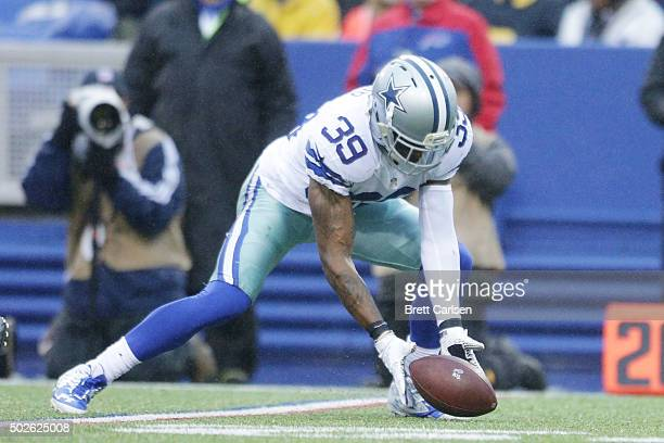 Brandon Carr of the Dallas Cowboys recovers a fumble against the Buffalo Bills during the second half at Ralph Wilson Stadium on December 27 2015 in...