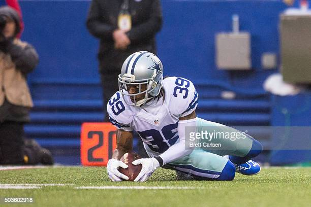 Brandon Carr of the Dallas Cowboys recovers a fumble during the game against the Buffalo Bills on December 27 2015 at Ralph Wilson Stadium in Orchard...