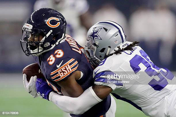 Brandon Carr of the Dallas Cowboys tackles Jeremy Langford of the Chicago Bears in the third quarter during a game between the Dallas Cowboys and the...