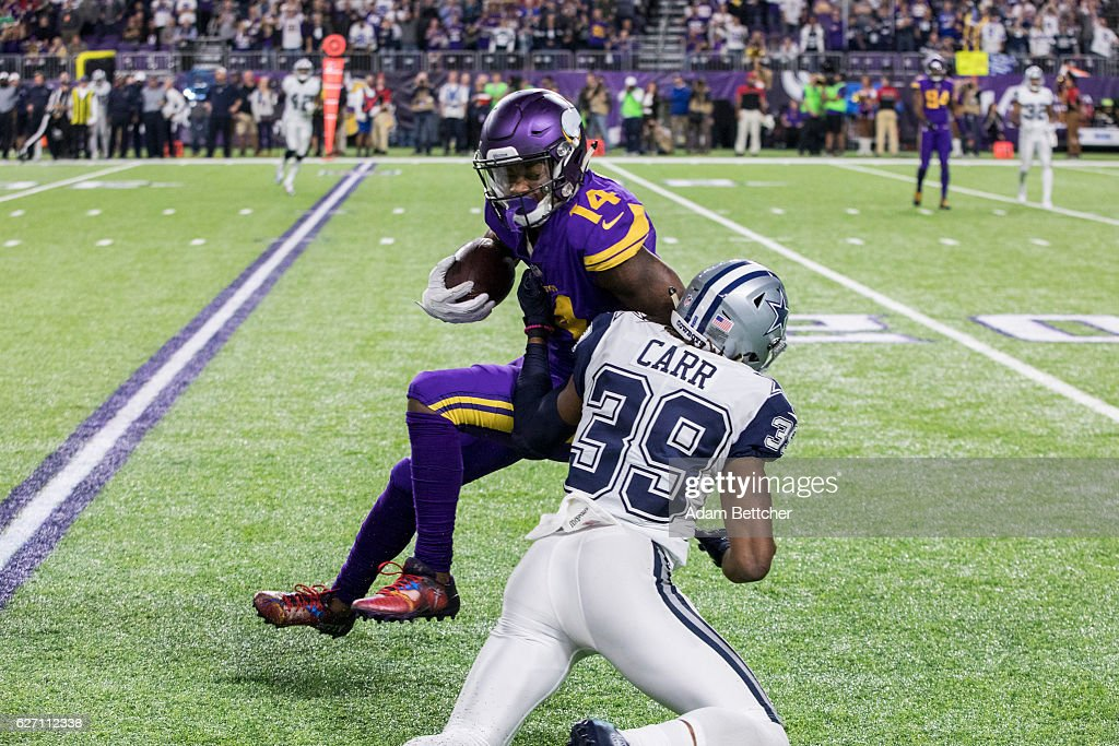 Brandon Carr #39 of the Dallas Cowboys tackles Stefon Diggs #14 of the Minnesota Vikings in the fourth quarter of the game on December 1, 2016 at US Bank Stadium in Minneapolis, Minnesota.