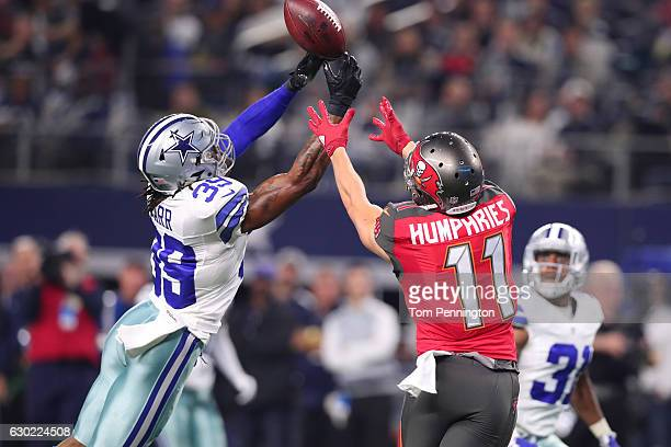Brandon Carr of the Dallas Cowboys tips a pass from Jameis Winston to Adam Humphries of the Tampa Bay Buccaneers during the third quarter at ATT...