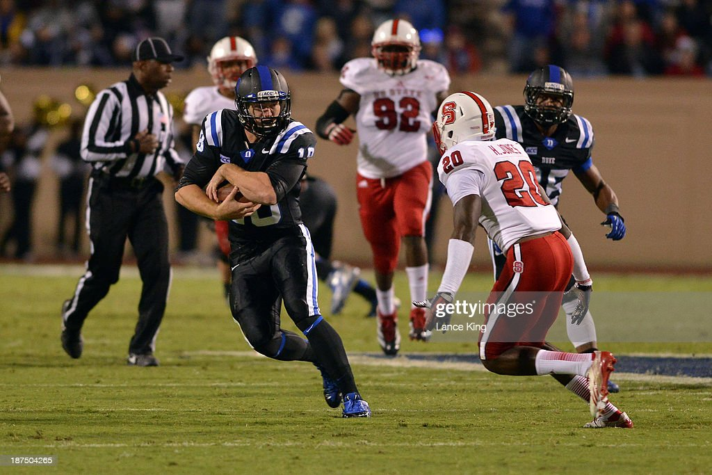 Brandon Connette #18 of the Duke Blue Devils runs with the ball against the North Carolina State Wolfpack at Wallace Wade Stadium on November 9, 2013 in Durham, North Carolina. Duke defeated NC State 38-20.