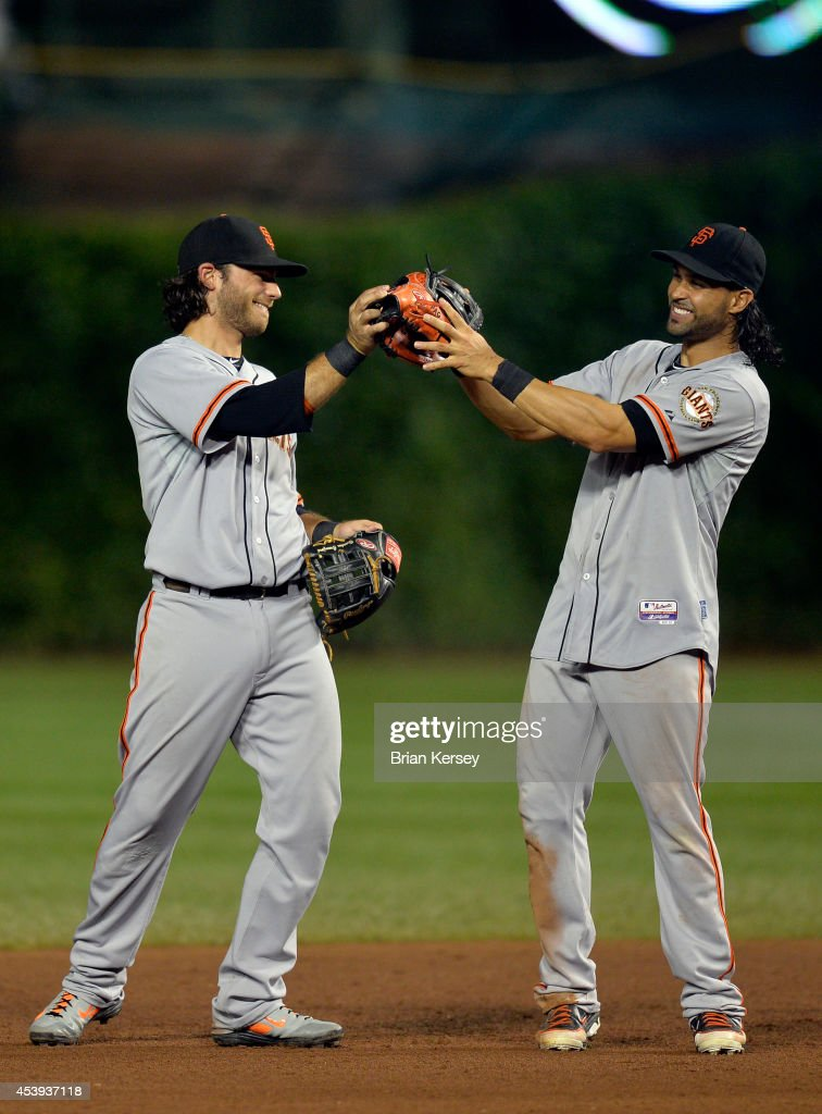 <a gi-track='captionPersonalityLinkClicked' href=/galleries/search?phrase=Brandon+Crawford&family=editorial&specificpeople=5580312 ng-click='$event.stopPropagation()'>Brandon Crawford</a> #35 (L) and <a gi-track='captionPersonalityLinkClicked' href=/galleries/search?phrase=Angel+Pagan&family=editorial&specificpeople=666596 ng-click='$event.stopPropagation()'>Angel Pagan</a> #16 of the San Francisco Giants celebrate their win over the Chicago Cubs at Wrigley Field on August 21, 2014 in Chicago, Illinois. The Giants defeated the Cubs 5-3.