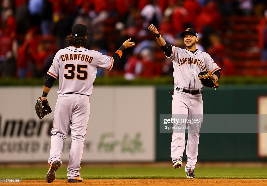 <a gi-track='captionPersonalityLinkClicked' href=/galleries/search?phrase=Brandon+Crawford&family=editorial&specificpeople=5580312 ng-click='$event.stopPropagation()'>Brandon Crawford</a> #35 and <a gi-track='captionPersonalityLinkClicked' href=/galleries/search?phrase=Gregor+Blanco&family=editorial&specificpeople=4137600 ng-click='$event.stopPropagation()'>Gregor Blanco</a> #7 of the San Francisco Giants celebrate after their 3 to 0 win over the St. Louis Cardinals during Game One of the National League Championship Series at Busch Stadium on October 11, 2014 in St Louis, Missouri.