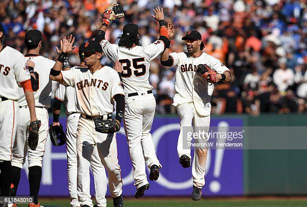 Brandon Crawford Angel Pagan and teammates of the San Francisco Giants celebrates defeating the Los Angeles Dodgers 30 at ATT Park on October 1 2016...